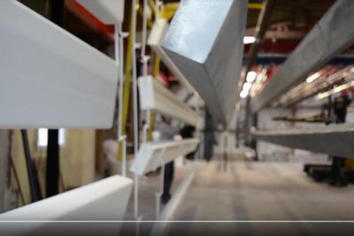 Thermolaquage : chargement du four de 12m avec système de 5 rails