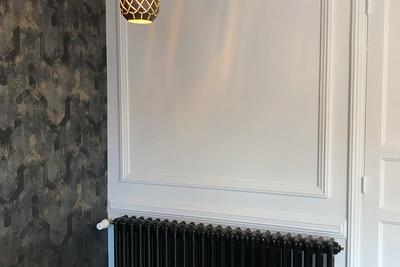 Rénovation d''un radiateur en fonte : noir brillant
