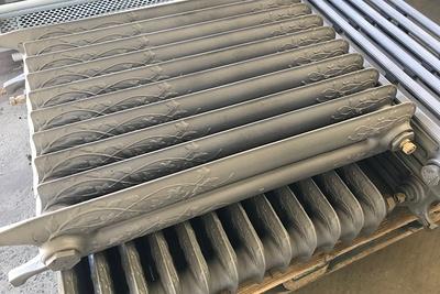 Sablage et thermolaquage de radiateurs en fonte
